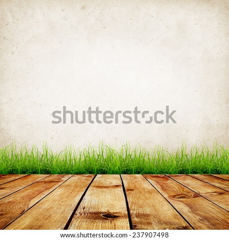 Old wall and green grass on wood floor background - stock photo