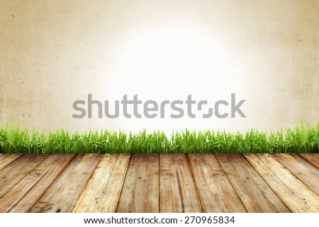 Old wall and wooden floor with grass background - stock photo