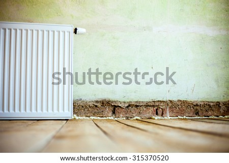 Old Wall Background with wood floor with radiator