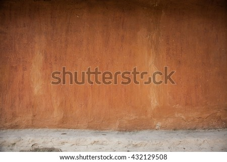 Old wall. Clay wall. Old village wall. Brown wall. Empty wall background.Ukraine village wall. Ukrainian rural house - stock photo