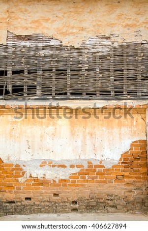 Old wall combination by brick and bamboo webbed structure in early Rattanakosin period texture background