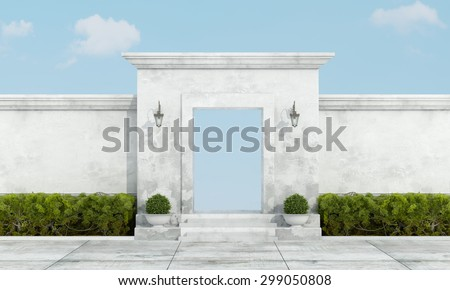 Old wall fence with stone portal without gate on blue sky - stock photo