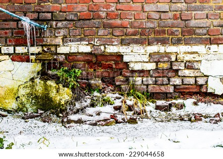 old wall in winter - stock photo