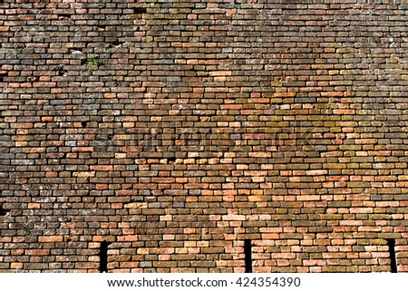old wall of red and orange bricks for texture, or background