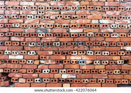 Old wall of red briks tiled background, regular block texture - stock photo