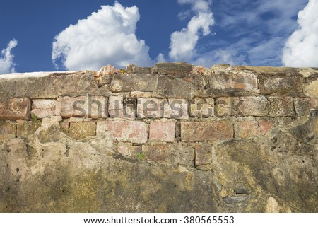 Old wall on blue sky