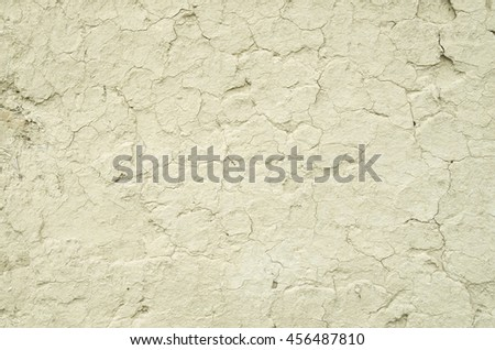 Old wall plastered with mud closeup in sunny day - stock photo