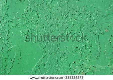Old wall. The texture of the old shabby wall in green. - stock photo