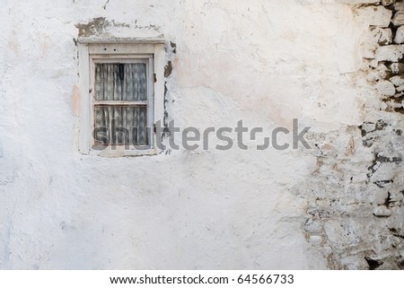 Old wall with a window with curtain shattered. Background. Texture - stock photo