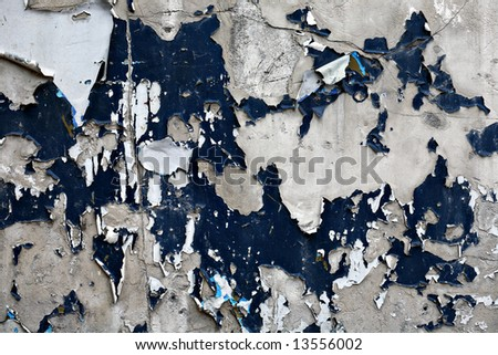 Old wall with peeling paint. - stock photo