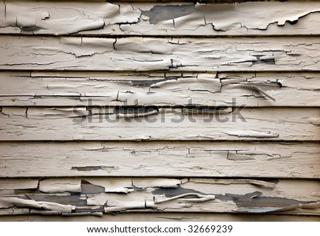 Old wall with peeling paint - stock photo