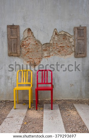 old wall with vintage chair