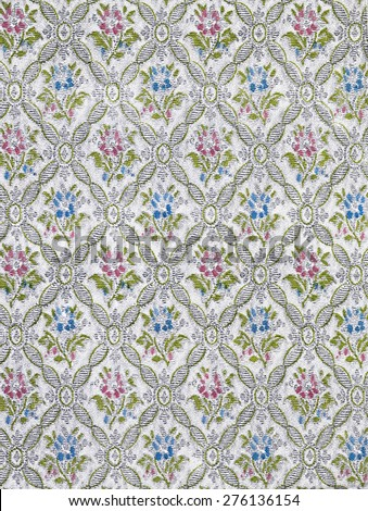 Old wallpaper with floral pattern in pastel colors - stock photo