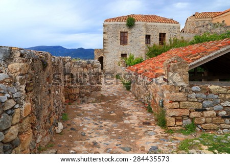 Old walls and buildings of a Byzantine town under cloudy sky, Monemvasia, Greece