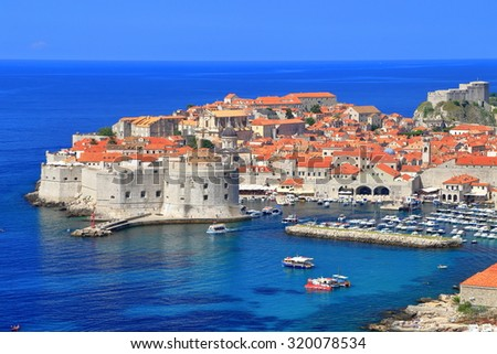 Old walls and buildings of Dubrovnik surrounded by the Adriatic sea, Croatia