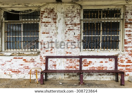 Old walls and chairs - stock photo