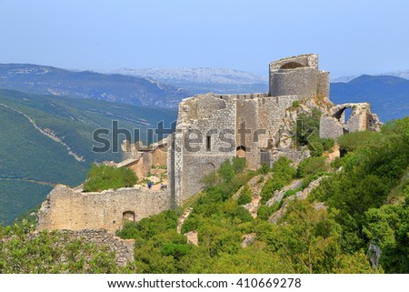 Old walls of Peyrepertuse castle surrounded by woods, Aude, Languedoc-Roussillon, France