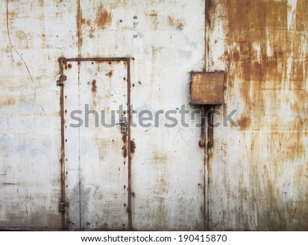 Old warehouse steel doors - stock photo