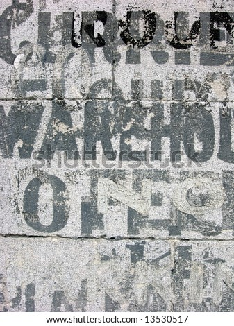 old warehouse stencils on concrete - stock photo