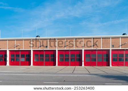 old warehouse with red doors in the rotterdam harbor - stock photo