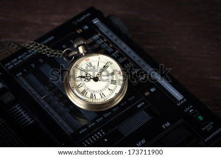 old watch and retro radio - stock photo
