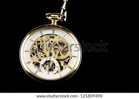 Old watch machine on dark background - stock photo