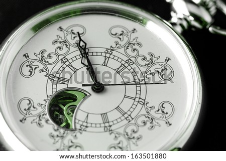 Old watch machine on dark background - green color - stock photo