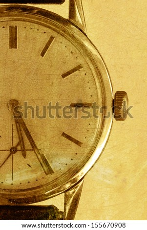 Old watch on a grunge sepia background
