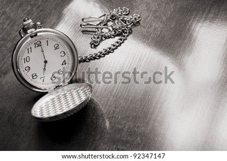 Old watch on wooden background - stock photo