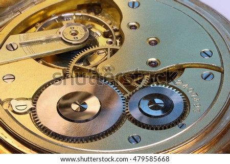 Old watch's mechanism, clockwork, gold with rubies