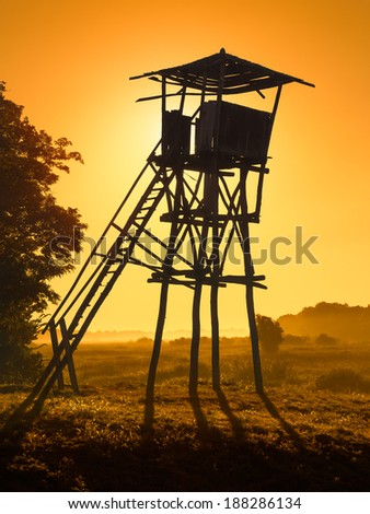 Old watchtower in the natural reservation at sunset - stock photo