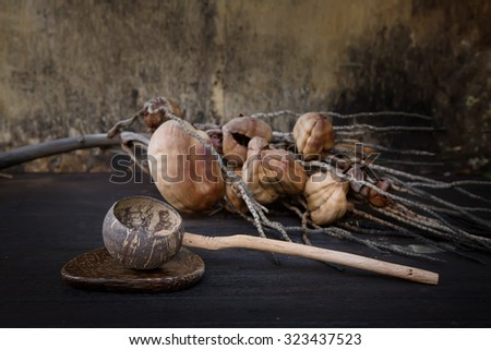 Old water dipper made from coconut shells.still life style