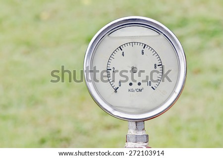 Old water pressure meter in close up view. - stock photo