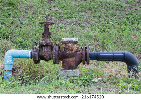Old water valve - stock photo