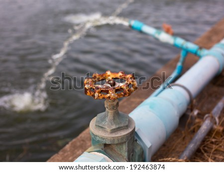 Old Water valve of Waste water treatment plant - stock photo