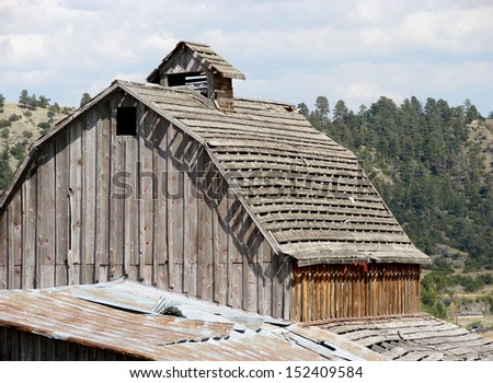 old weathered abandoned building barn roof - stock photo