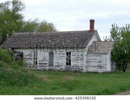 old weathered abandoned building white schoolhouse