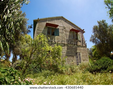 Old weathered abandoned western colonial style wooden house shed - stock photo