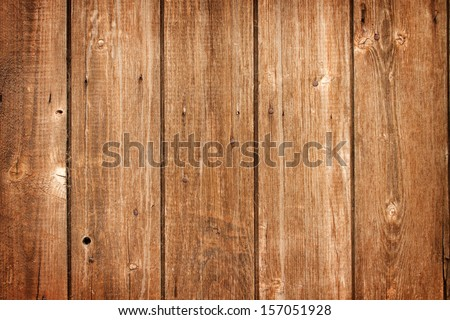 old weathered and textured wooden boards on a barn door - stock photo