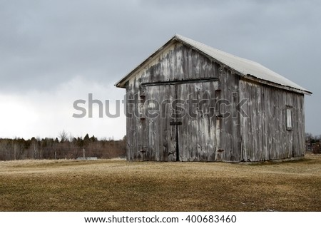Old weathered  barn with stormy clouds in background