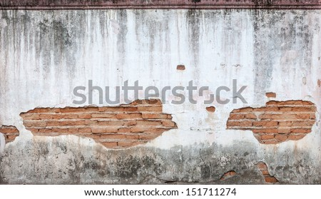 Old weathered brick wall fragment - stock photo