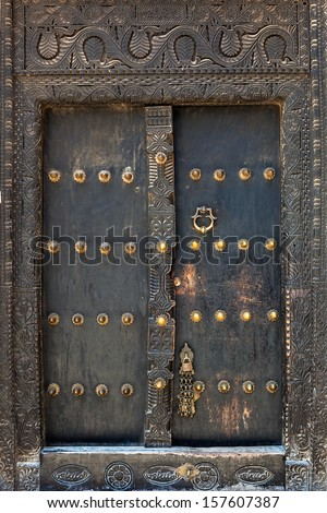 Old weathered door of building in Stone Town, Zanzibar, Tanzania