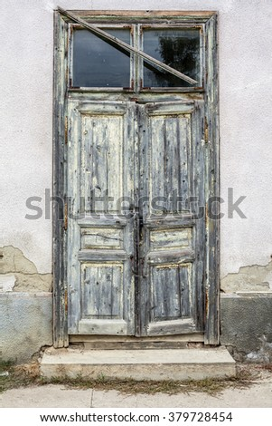 old weathered door with peeling paint