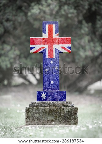 Old weathered gravestone in the cemetery - Australia - stock photo