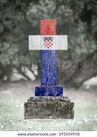 Old weathered gravestone in the cemetery - Croatia - stock photo