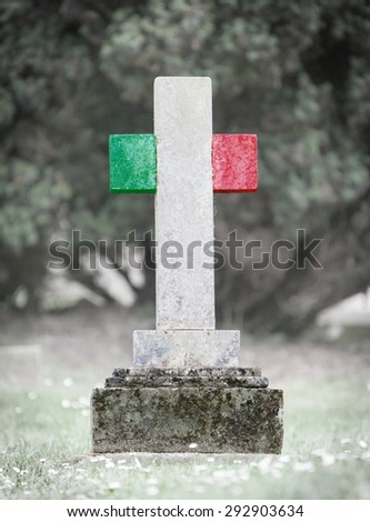 Old weathered gravestone in the cemetery - Italy - stock photo