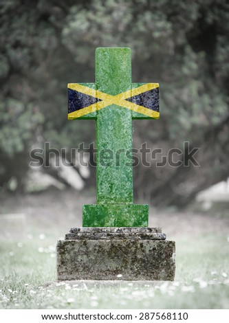 Old weathered gravestone in the cemetery - Jamaica - stock photo