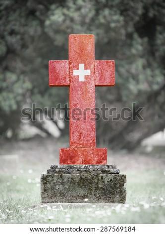 Old weathered gravestone in the cemetery - Switzerland - stock photo