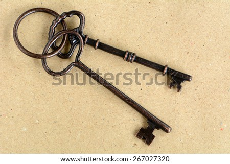 Old weathered keys on antique paper in horizontal format - stock photo