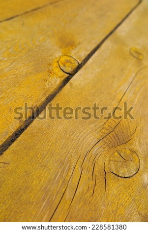 Old weathered pine boards being yellow painted - stock photo
